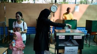 A woman votes in Bangkok