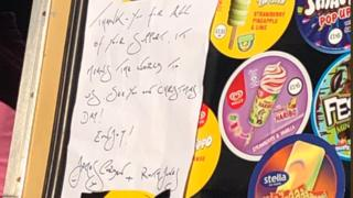 A picture of the note pinned to the ice cream van