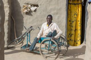 Soumaila Soumana outside his home in Norandé