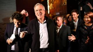 Republican presidential candidate, former Florida Gov. Jeb Bush, centre left, walks with members of the media and supporters as he departs a campaign event held in a barn belonging to former .S. Sen. Scott Brown, R-Mass., Tuesday, Nov. 3, 2015, in Rye, N.H