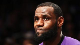 LeBron James of the Los Angeles Lakers looks on against the Brooklyn Nets during their game at the Barclays Center on December 18, 2018 in New York City.