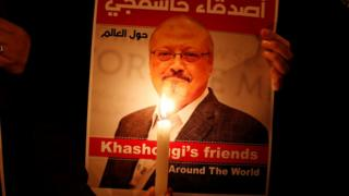 A protester holds a poster with a picture of Jamal Khashoggi in front of the Saudi Consulate in Istanbul, Turkey, October 25, 2018