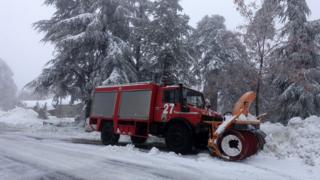 Snow plough getting to work