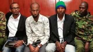Hassan Aden Hassan (L), Mohamed Ali Abikar (3rd L) and Rashid Charles Mberesero (3rd R) sit and wait for sentencing of abetting Somali jihadists who carried out a 2015 attack on Garissa University in northeast Kenya in which 148 people were killed at Milimani law Courts in Nairobi on July 3, 2019