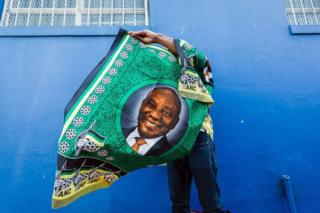A street vendor sells goods depicting South African President Cyril Ramaphosa on 12 January 2019.