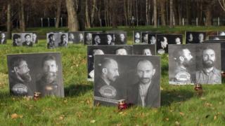 Фотографии репрессированных на Бутовском полигоне в Москве