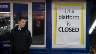 Man looking at closed sign