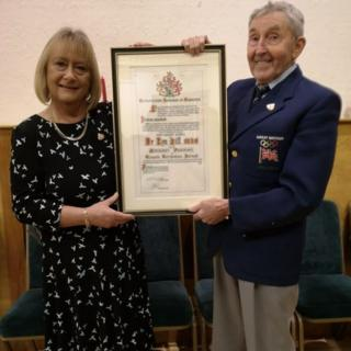 Ron Hill with certificate awarded for Freedom of the Borough of Tameside