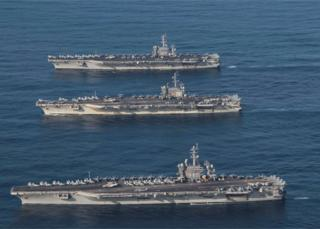 The aircraft carriers USS Ronald Reagan (CVN 76), USS Theodore Roosevelt (CVN 71) and USS Nimitz (CVN 68) in the western Pacific, 12 November 2017