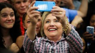 Democratic presidential candidate Hillary Clinton takes photographs with supporters after a campaign rally at Sacramento City College on 5 June 2016 in Sacramento, California.