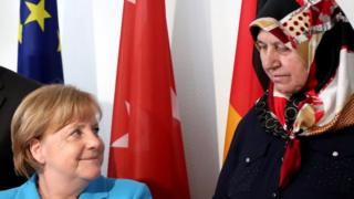German Chancellor Angela Merkel (L) and Mevlude Genc (R), surviving relative of the Solingen arson attack, during the commemoration ceremonies