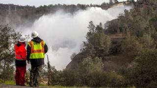A team from the Department of Water Resource, monitors the section of damaged main spillway at Oroville dam in Oroville, California, USA, 13 February 2017