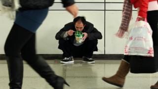 Man eats noodles