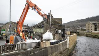 Workers construct flood defences in Mytholmroyd ahead of Storm Dennis