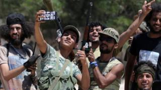 Members of the Libyan army's special forces take a selfie before entering the area of clashes with Islamist militants in their last stronghold in Benghazi, Libya, July 5, 2017