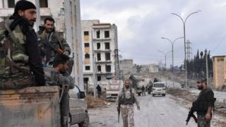 """Syrian pro-government forces set up an outpost on December 2, 2016 in the Aleppo""""s eastern neighbourhood of Sakan al-Shababi"""
