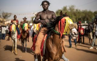 A horseman prepares to parade for the opening ceremony of the Panafrican Film and Television Festival in Ouagadougou, on February 23, 2019