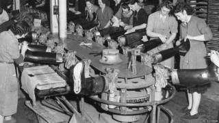 Production line workers making wellington boots at the North British Rubber Company in Edinburgh