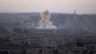 Smoke rises from Bustan al-Basha neighborhood of Aleppo