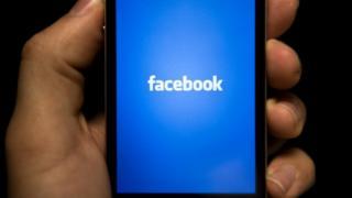 A Facebook logo on a phone screen