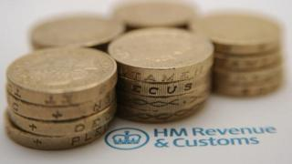 Coins on HM Revenue and Customs paperwork