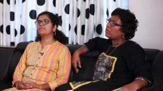 Kanaka Durga and Bindu Ammini sit on sofa in screenshot