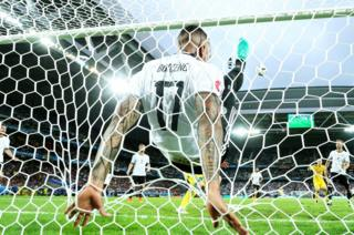 German defender Jerome Boateng clears the ball from the line at Stade Pierre Mauroy in Lille Metropole