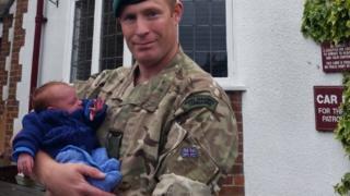 Sgt Matt Harness with baby Spencer