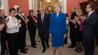 Theresa May is welcomed back to Downing Street after accepting an invitation to form a government