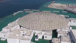 The billion-dollar Louvre museum shimmering in the Abu Dhabi desert