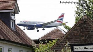 A British Airways plane approaches Heathrow