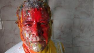A picture of Egyptian human rights lawyer Gamal Eid covered in paint