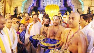 This handout picture released by the Public Relation Department of the Government of Telangana and taken on February 22, 2017, Telangana Chief Minister K Chandrashekhar Rao (centre L) with family members and supporters carrying lavish offerings for a temple in Tirumala.