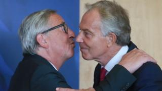 Jean-Claude Juncker greeting former PM Tony Blair with a kiss.