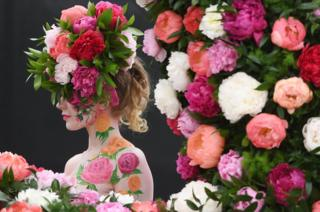 A model poses at Chelsea Flower Show
