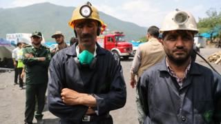 Handout photo from Iranian presidency shows coal miners and rescue workers outside Zemestan-Yurt mine following deadly explosion (7 May 2017)