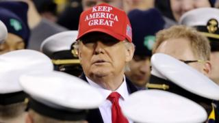 Donald Trump stands with the Navy side of the field to start the second half of the game between the Army Black Knights and the Navy Midshipmen at Lincoln Financial Field on December 14, 2019 in Philadelphia
