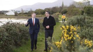 Infrastructure Minister Chris Hazzard and Jonathan Hobbs from NI Greenways walk along the old railway track near Dundrum, as the Minister launches his plan to develop 1000kms of greenways paths across the north, 9 November 2016