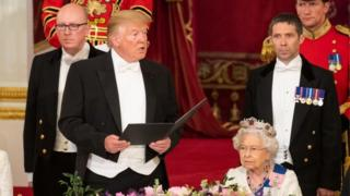 US President Donald Trump makes a speech as Queen Elizabeth II listens during a State Banquet at Buckingham Palace on3 June 2019 in London, England