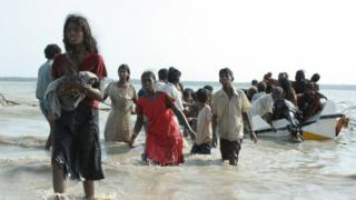 This handout picture released by the Sri Lankan Army on May 15, 2009 allegedly shows civilians who managed to escape from the last remaining Tamil Tiger rebel-held patch of coastline in the northeastern district of Mullaittivu.