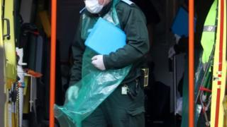 environment Paramedic wearing protective apron