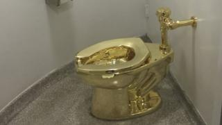 Gold toilet by Maurizio Cattelan