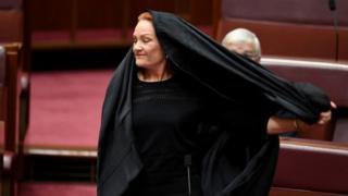 Pauline Hanson removes a burka in Austalia's Senate last month