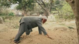 Mohammad Shareef just finishing a burial