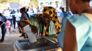 A women cast her ballot as part of the general elections, on March 7 at a polling station in Freetown. More than 3.1 million voters are registered for the polls.