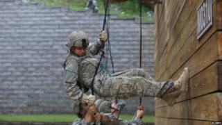 A female Ranger student tackles rappel training during the second phase of Ranger School at Camp Frank D Merrill in northern Georgia on 12 July