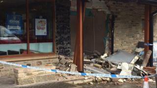 Hole where stolen ATM had been