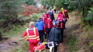 Aberdyfi Search and Rescue Team carry the patient following the incident