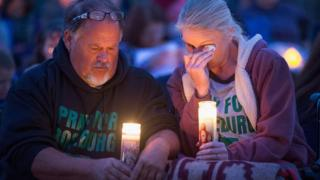 Roseburg residents attend a candlelight prayer vigil following the shootings.
