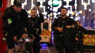 Armed police in Oxford Street